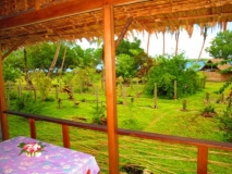 View over garden to lagoon from Large Semi-Deluxe bungalow